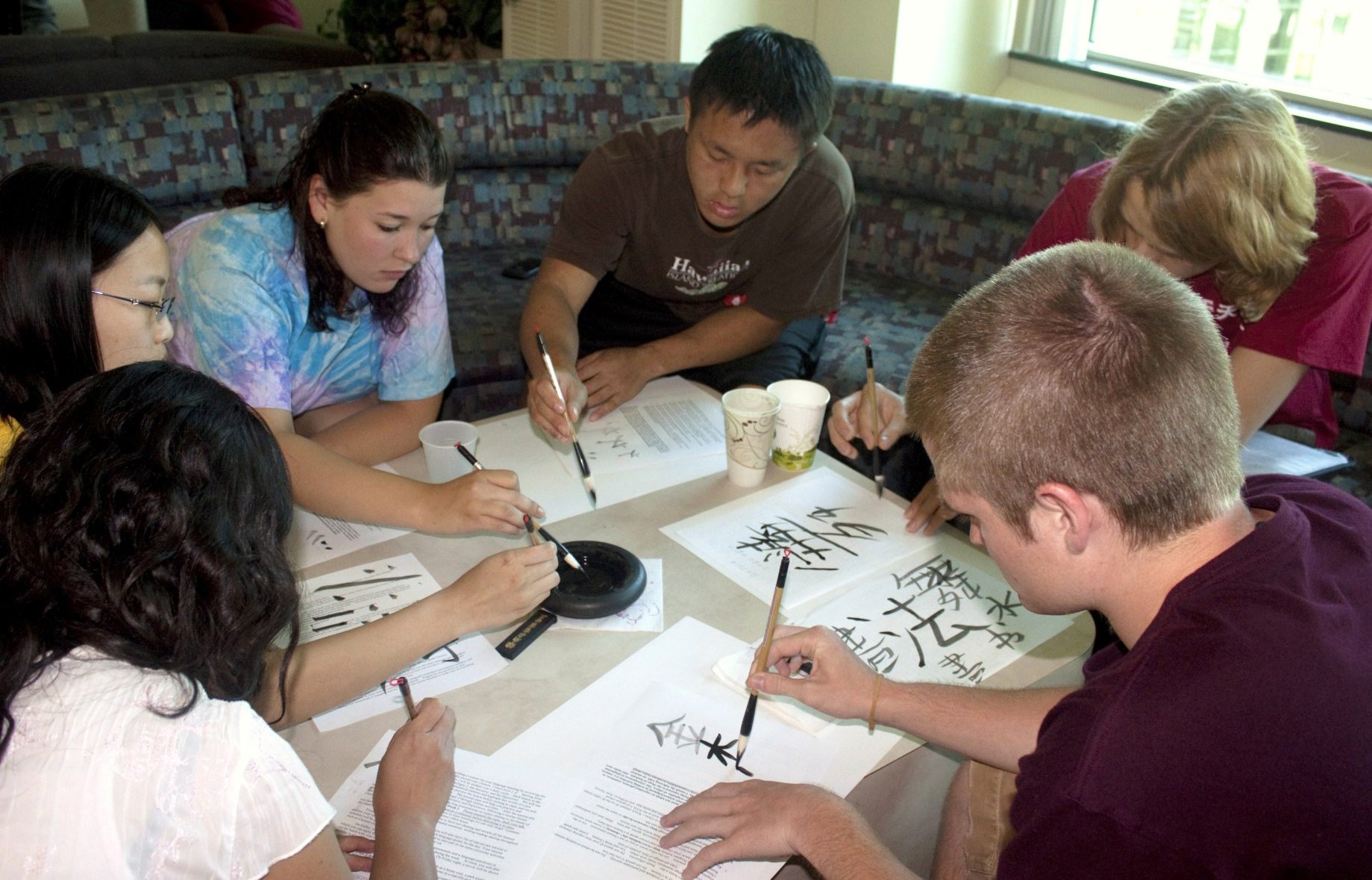 Students working on Chinese Calligraphy