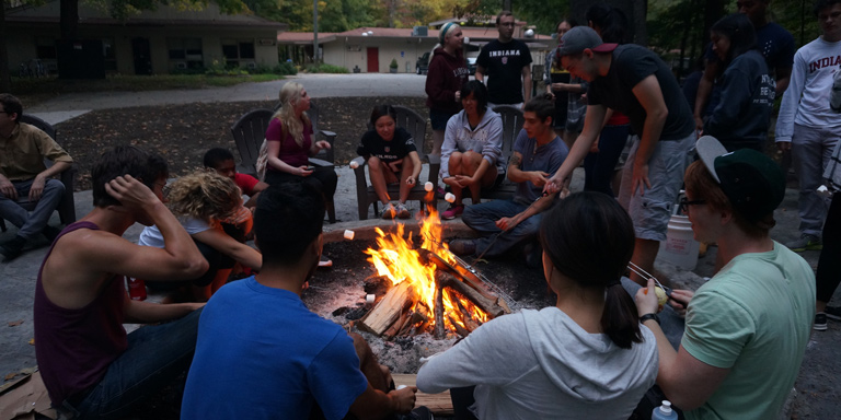 Group of students around a campfire