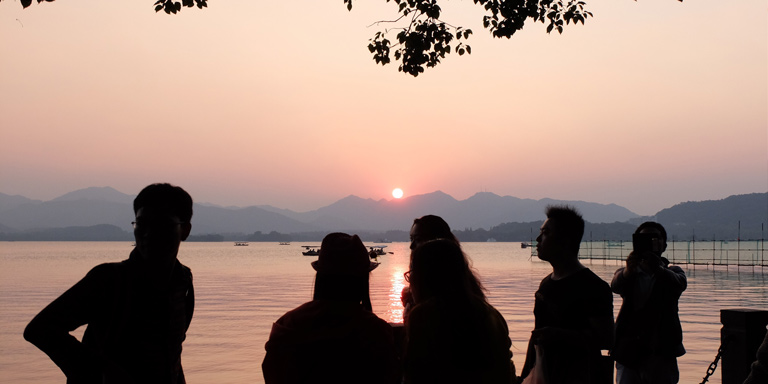 Students watching a sunset
