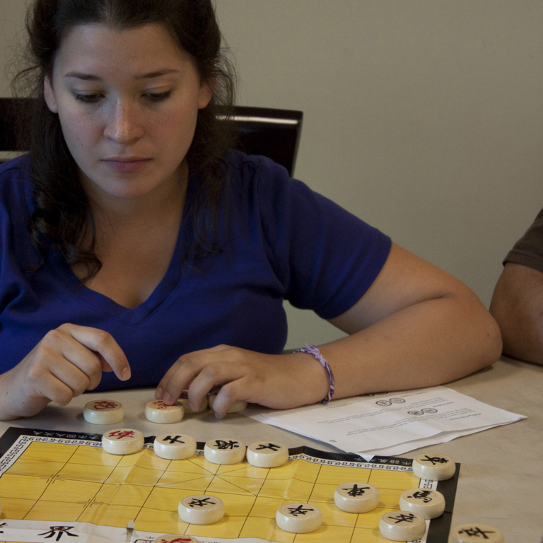Student learning Chinese board game