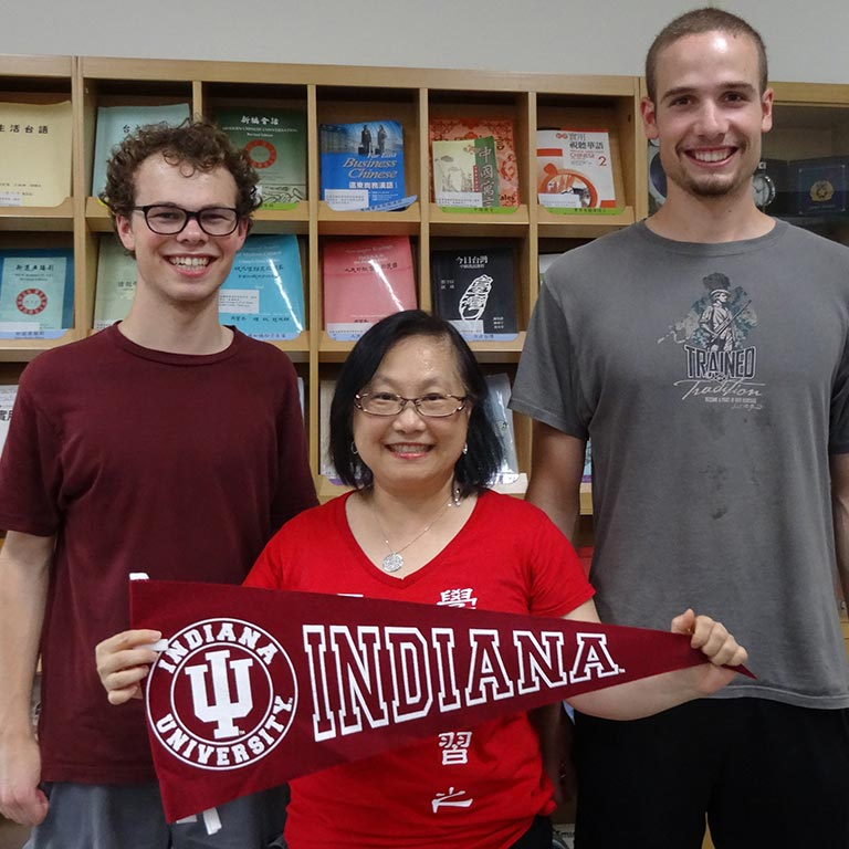 Group with IU pennant flag